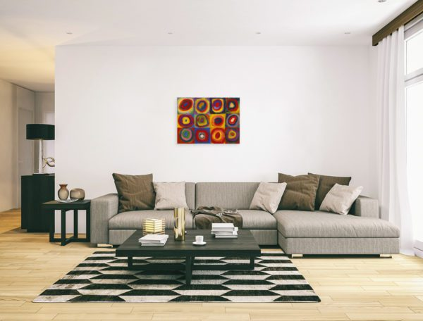 Photo of Color Study Squares with Concentric Circles Print in modern minimalistic living room.