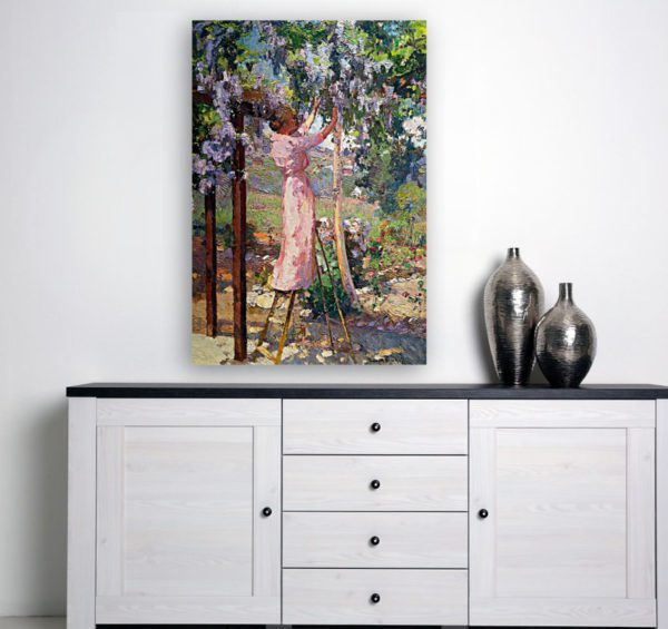 Photo of Lady in trees painting over a simplistic table